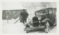 John W. Oliver with mailbags in the snow