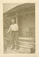 "John W. Oliver posing with rifle ""Old Bean"""