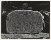The Cumberland Jack grave stone made by Jim Robertson in front of studio, June 7, 1974