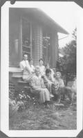 Mr. O. J. Mattil, Evelyn Bishop, Mrs. Anna Dowell, Annie Laurie, Aunt Lizzie Reagan, Helen Chew, unidentified woman and Rex the dog