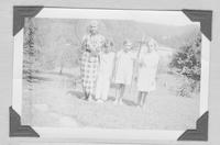 Mrs. Eunice Weaver, director, and three pupils