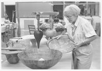Sandy Blain examines turned wooden bowls.
