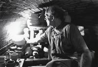 Instructor, Jack Troy, stacks pots inside Arrowmont's anagama kiln.  July 20-31, 1992.