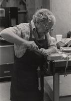 Elderhostel student, Virginia Fain, works on a small tray during a wood carving class at Arrowmont, May 1985.