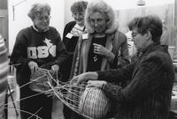 Instructor Lee Zimmerman, right, with several enthusiastic wicker basketry students. (May 4-7, 1995)
