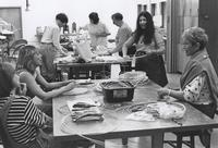 Faculty member Kim Keats (second from far right) demonstrates natural material basketry techniques to a group of Pi Phi Arts Weekend students, April 30-May 3, 1998.