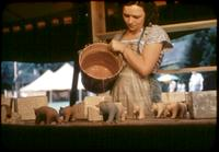 Woman pouring clay into molds.