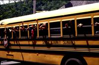 Kids waving goodbye from Sevier County School Bus.