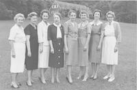 Gatlinburg in front of Staff House.  Left to right: Lois Summers, Marian Prince Hensle, Olivia Moore, Helen Russell, Helen Dix, Zoe James, Marian Heard.  Settlement School Committee 1958-63.