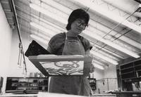Screenprinting student at work in Arrowmont's textile studio.  Summer 1987.