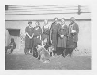 Students and teachers with dogs