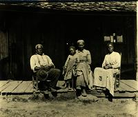 African American family sitting on the front porch