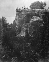 Group sitting on Look Rock, Chilhowee Mountain: B. G. Simmons, Mrs. Simmons, Mrs. Chadwick, Letitia Garner, Karl, and Herman and Tip the dog