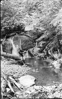 Linnaeus Hastings cools off beside a small waterfall on Pole Bridge Branch