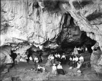 Group of men, women and children inside Sheep Pan Bluff, near Louisville, Tennessee