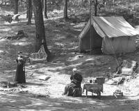 Camp at Maple Springs, closeup of tent and two women