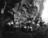 Group of men, women, and dogs at the entrance to Sheep Pan Bluff, Louisville, Tennessee