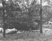 Major McTeer and his wife outside their tent at Maple Springs Camp