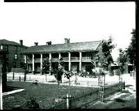 Became Verandah Hotel in 1852 when columns were added; fence and porch is for A. K. Harper House