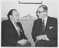 Estes Kefauver and unidentified man sit and talk