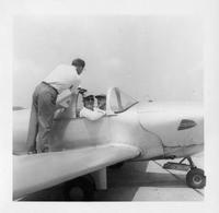 Kefauver with two unidentified men with airplane