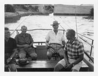 Estes Kefauver on boat with three unidentified men