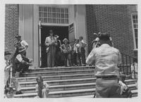 Kefauver, wearing a Shriner's fez, addresses crowd from building steps at Catfish Derby event in Savannah Tennessee, July 29, 1957