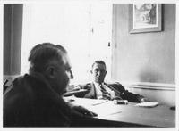 Estes Kefauver meeting with another man in office setting