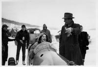 Nancy Kefauver in bobsled with Estes Kefauver looking on