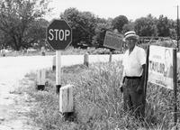 Man showing proximity of Andrew Taylor's sign to road by Crockett's Mill, Tennessee