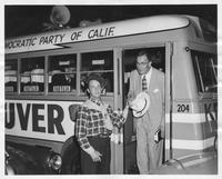 Kefauver exits campaign bus with young man in coonskin cap and Estes Kefauver with coonskin cap tie