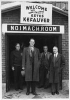 Estes Kefauver and unidentified group in front of machine room in Lincoln New Hampshire