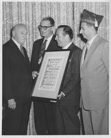 Estes Kefauver and others present framed certificate