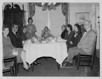 Estes Kefauver with unidentified group at dinner table after funeral for his father