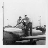 Kefauver with unidentified man and airplane