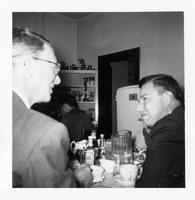 Estes Kefauver has meal with tobacco buyer at kitchen of house in Tazewell, Tennessee