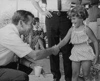 Howard Baker Shaking Hands with Child during Campaign in Tennessee