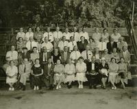 Group sitting on bleachers