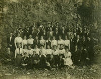 Group portrait in front of cave