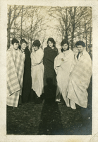 Six girls wrapped in blankets