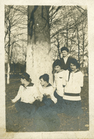 Five girls sitting under a tree