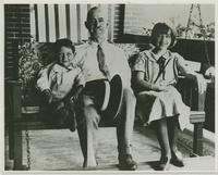 Man, Boy and Girl on Swing