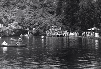 Swimmers at unidentified lake