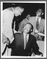 Dr. Martin Luther King, Jr. shakes hands with Benjamin L. Hooks