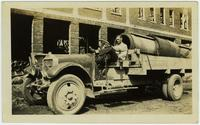 Raymond G. Whitfield on a white truck with gravel washing cylinders