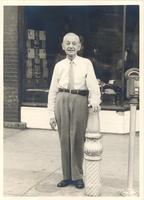 Sam Licker in front of his shoe store on the Square