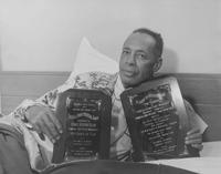 Coach Henry A. Kean with the Coach of the Year and Football Co-Championship trophies in 1954