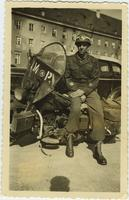 Gaskell Warren posing with his M.P. motorcycle in Munich, Germany in July, 1945
