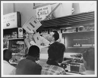Students conduct a lunch counter sit-in