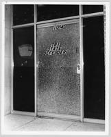 Shattered window and door of the Tri-State Defender newspaper